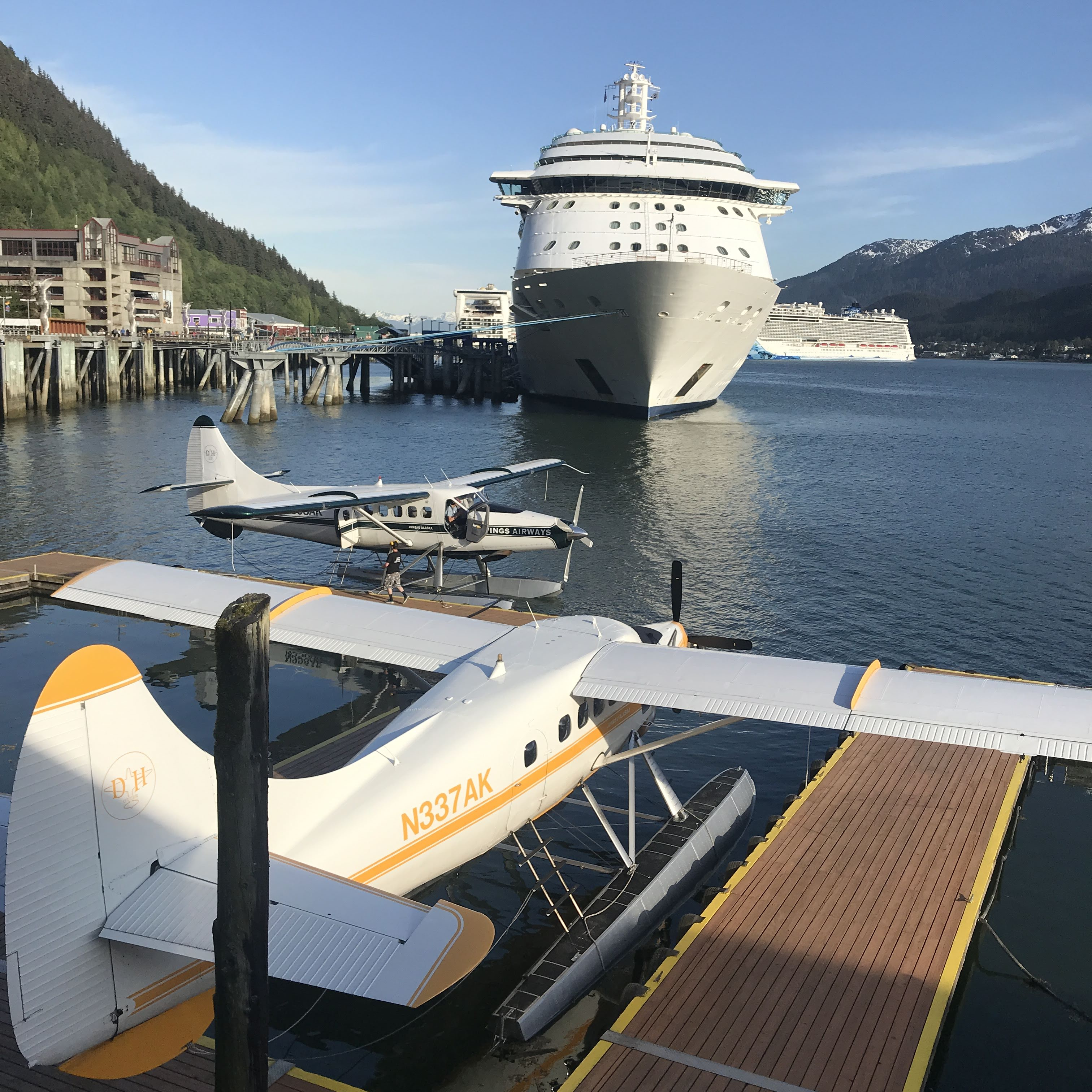 Several cruise ships and floatplanes dot the harbor in Juneau.
